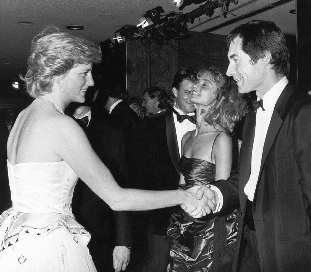 """In this Monday, June 29, 1987 file photo, Princess Diana meets Timothy Dalton, who succeeded Roger Moore as James Bond at the charity premiere of """"The Living Daylights"""" at London's Odeon Cinema. The Welshman, who was a trained Shakespearean actor, played Bond twice. His interpretation of Bond was far grittier than Moore's. After his second outing as Bond, 1989's """"License To Kill"""", legal issues meant Bond wouldn't return again until 1995's """"Goldeneye"""", when Pierce Brosnan took the role of 007. The upcoming new Bond film """"Spectre"""" starring Daniel Craig has its World Premiere on Monday Oct. 26, 2015, in London. (Photo by AP Photo)"""