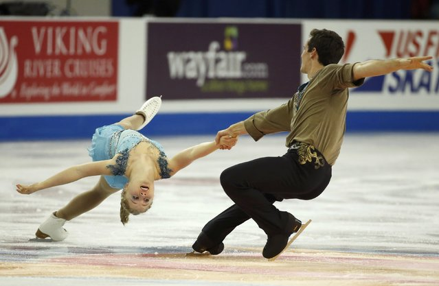 Julianne Seguin and Charlie Bilodeau of Canada perform during the Pairs short program at the Skate America figure skating competition in Milwaukee, Wisconsin October 23, 2015. (Photo by Lucy Nicholson/Reuters)