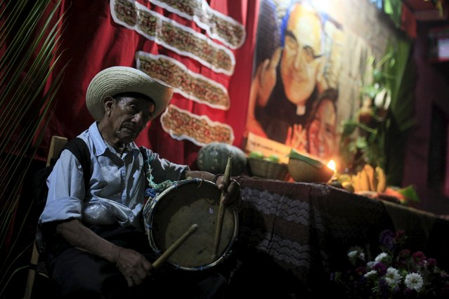 """A man plays the drum at a family altar during the celebration of """"Los Canchules"""" in Nahuizalcoams November 1, 2015. (Photo by Jose Cabezas/Reuters)"""