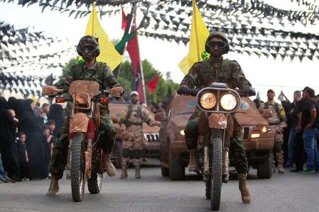Hezbollah members on motorbikes and vehicles parade during a procession ahead of the day of Ashura, in the Saksakieh village, in southern Lebanon, October 9, 2016. (Photo by Ali Hashisho/Reuters)