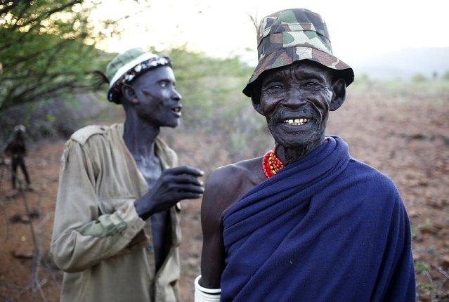 Turkana men stand outside a village inside the Turkana region of the Ilemi Triangle, northwest Kenya December 20, 2014. (Photo by Goran Tomasevic/Reuters)