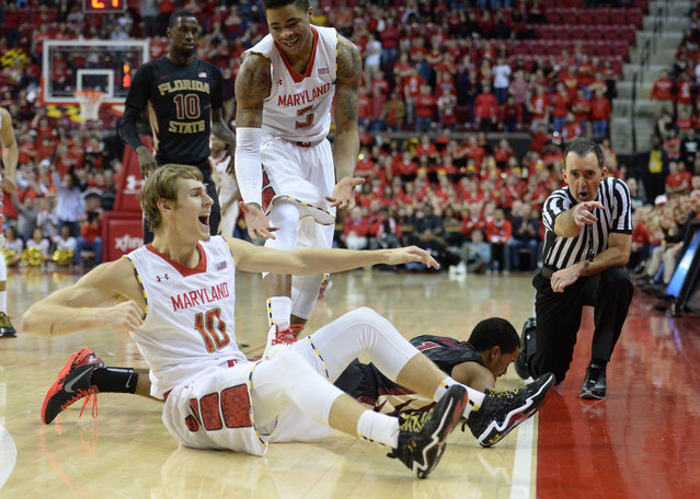 Maryland Terrapins forward Jake Layman (10) celebrates as the official rules the ball out of bounds for a Maryland possession during the final minutes of action against Florida State  on February 7, 2014 in College Park, MD.  (Photo by Jonathan Newton/The Washington Post)