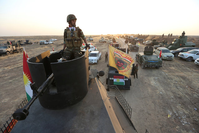 A member of the Peshmerga forces sits on a military vehicle at north of Mosul, during an operation to attack Islamic State militants in Mosul, Iraq, October 20, 2016. (Photo by Ari Jalal/Reuters)