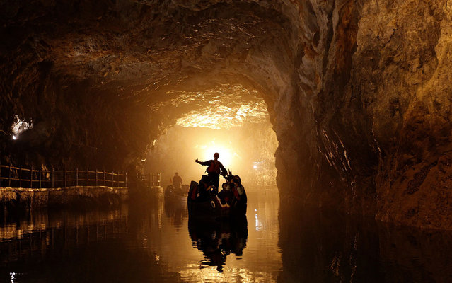 Tourists on traditional boats sail in the Beihai military water tunnels on the island of Nangan in the Matsu archipelago, off northern Taiwan, on May 8, 2013. The Matsu archipelago, which was once front line against China, is now a military tourist spot. (Photo by Pichi Chuang/Reuters)