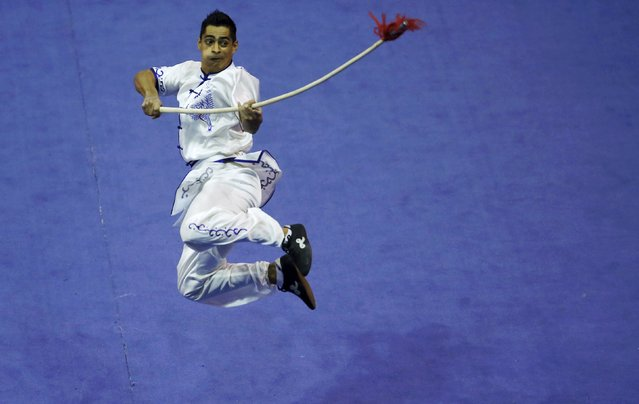 Argentina's Pablo German Trozzo competes in the men's qiangshu final during the 13th World Wushu Championship 2015 at Istora Senayan stadium in Jakarta, November 17, 2015. (Photo by Reuters/Beawiharta)