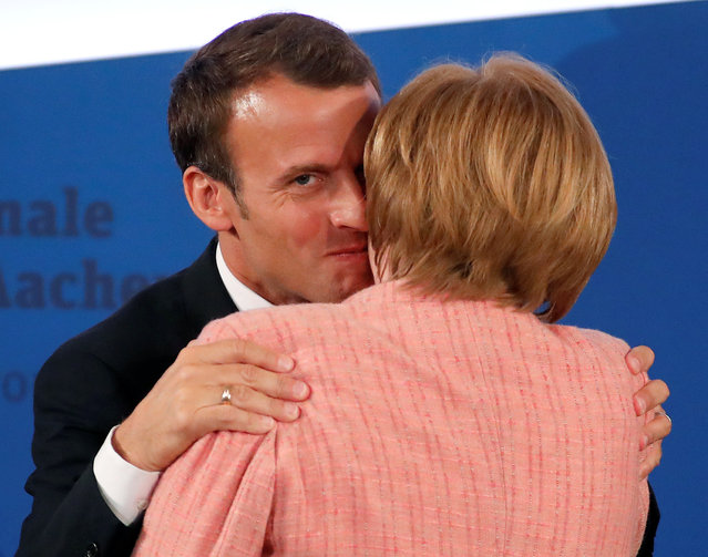French President Emmanuel Macron is congratulated by German Chancellor Angela Merkel after being awarded the Charlemagne Prize during a ceremony in Aachen, Germany May 10, 2018. (Photo by Wolfgang Rattay/Reuters)