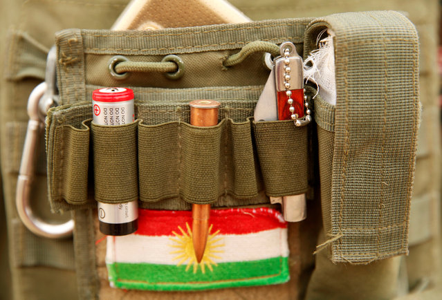 A bullet and the Kurdistan flag are seen on a Peshmerga fighter's vest during a battle with Islamic State militants near Bashiqa, Iraq, October 28, 2016. (Photo by Ahmed Jadallah/Reuters)