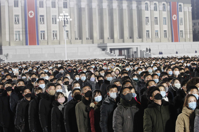 People watch the national flag raising ceremony and fireworks display to celebrate the New Year, at Kim Il Sung Square in Pyongyang, North Korea, early Friday, January 1, 2021. (Photo by Jon Chol Jin/AP Photo)