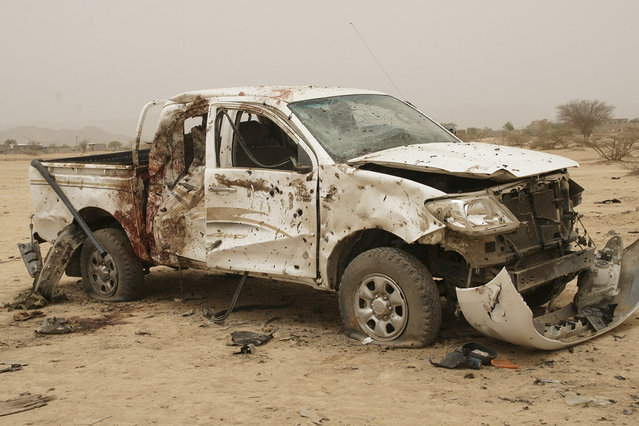 A vehicle belonging to al Qaeda-linked militants and destroyed during clashes with the army, is seen at the front line in the southern province of Abyan June 4, 2012. (Photo by Reuters/Yemen's Defence Ministry)