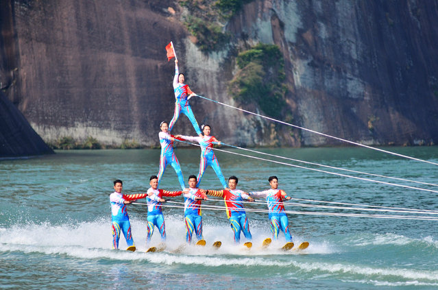 Participants give a performance on a river during a showcase at a tourism resort in Chenzhou, Hunan Province, China, November 6, 2016. (Photo by Reuters/Stringer)