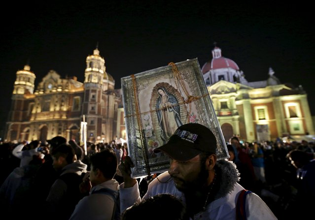 A pilgrim holds up an image of the Virgin of Guadalupe at the Basilica of Guadalupe during the annual pilgrimage in honor of the Virgin of Guadalupe, patron saint of Mexican Catholics, in Mexico City, Mexico December 12, 2015. (Photo by Henry Romero/Reuters)