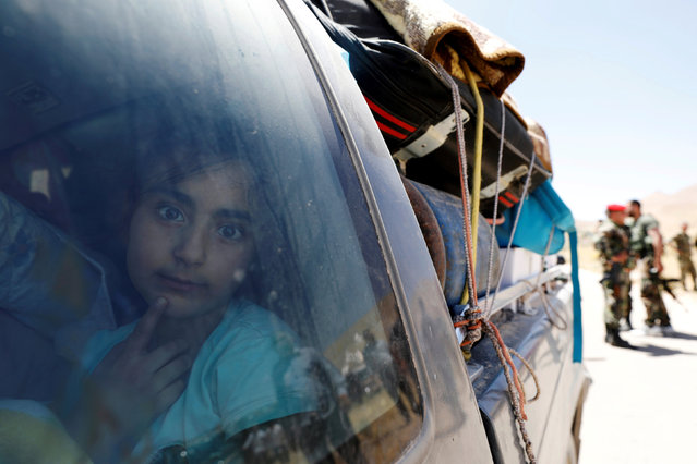 A Syrian refugee girl who left Lebanon looks through a window as she arrives in Qalamoun, Syria June 28, 2018. (Photo by Omar Sanadiki/Reuters)