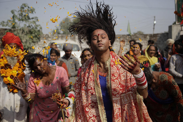 Devotees whirl their head as a ritualistic performance during the annual Jhiri Fair at Kanachack village, outskirts of Jammu, India, Monday, November14, 2016. According to the villagers,  the fair is held in memory of Baba Jitu, an honest farmer who killed himself since he was not prepared to submit to the unjust demands of a landlord who wanted him to part with his crop. (Photo by Channi Anand/AP Photo)