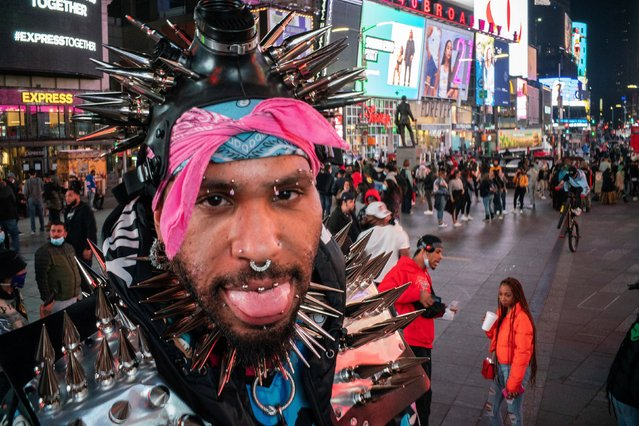 People without face masks are seen at Times Square during the coronavirus disease (COVID-19) pandemic in New York City, U.S., March 11, 2021. (Photo by Eduardo Munoz/Reuters)