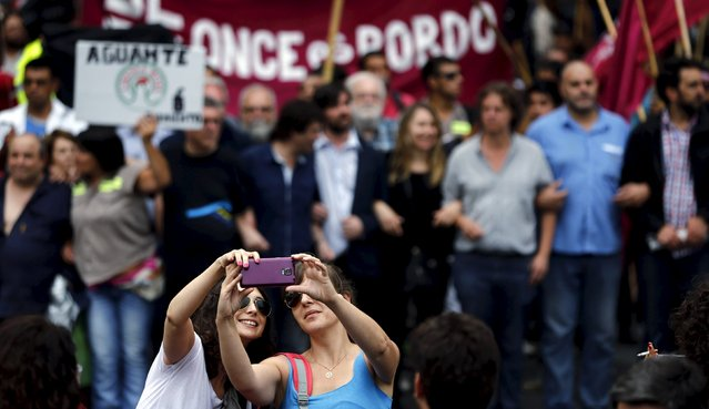 Two women take a selfie during a protest against economic policies implemented by Argentina's President Mauricio Macri in Buenos Aires, Argentina, December 22, 2015. (Photo by Marcos Brindicci/Reuters)