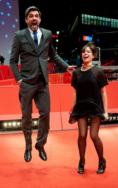 "Director Sebastian Schipper and cast member Laia Costa jump as they arrive on the red carpet for the screening of their in competition film ""Victoria"" at the 65th Berlinale International Film Festival in Berlin February 7, 2015. (Photo by Stefanie Loos/Reuters)"