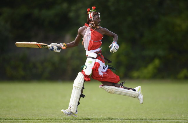 "Papai Simon Ole Mamai of the Maasai Cricket Warriors team from Kenya runs during a match against English team ""The Shed"" during ""The Last Man Stands"" cricket tournament at Dulwich sports ground in South London September 1, 2013. (Photo by Philip Brown/Reuters)"