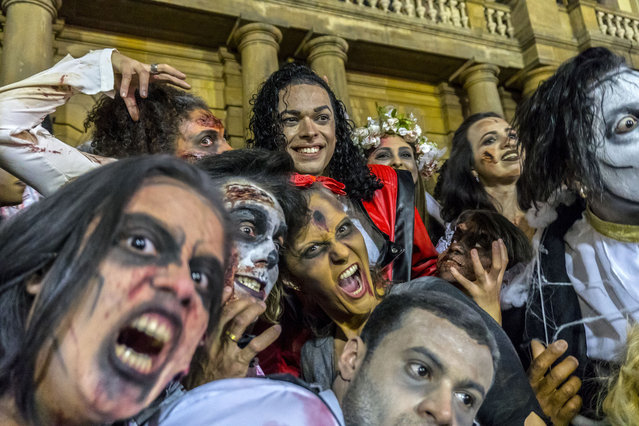 Fans of singer Michael Jackson flashmob on the steps of the Municipal Theater in São Paulo dancing Thriller on the day that the singer would turn 60 if he were alive, August 29, 2018. (Photo by Cris Faga/NurPhoto via Getty Images)