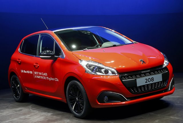 A Peugeot 208 is seen during the first press day ahead of the 85th International Motor Show in Geneva March 3, 2015. REUTERS/Arnd Wiegmann