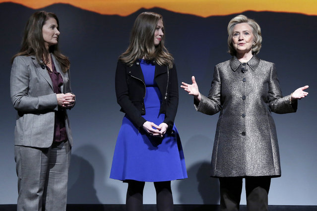 "Melinda Gates, left, Chelsea Clinton, center, and Hillary Rodham Clinton participate in the ""No Celings: The Full Participation Project,"" in New York, Monday, March 9, 2015. (AP Photo/Richard Drew)"