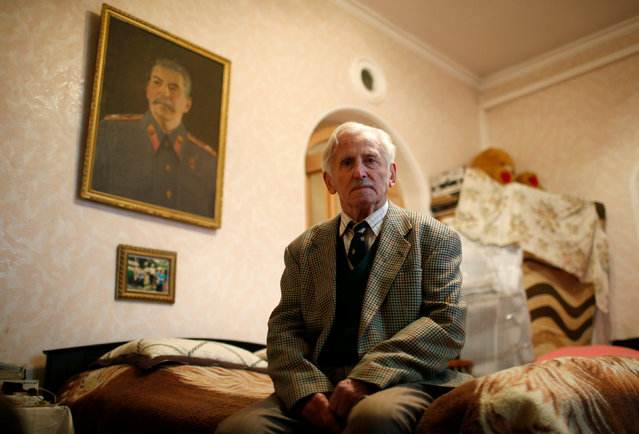 """Retired driver Ushangi Davitashvili, 86, poses for a portrait at his home in Tbilisi, Georgia, November 22, 2016. """"Stalin saved the world from fascism. He cared about people. Under his rule there was no unemployment. We had free education and healthcare. He was a great man"""", Davitashvili said. (Photo by David Mdzinarishvili/Reuters)"""