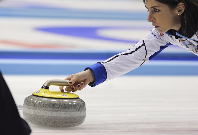 Scotland's skip Eve Muirhead delivers a stone during her team's curling round robin game against Denmark at the World Women's Curling Championships in Sapporo March 14, 2015. (Photo by Thomas Peter/Reuters)