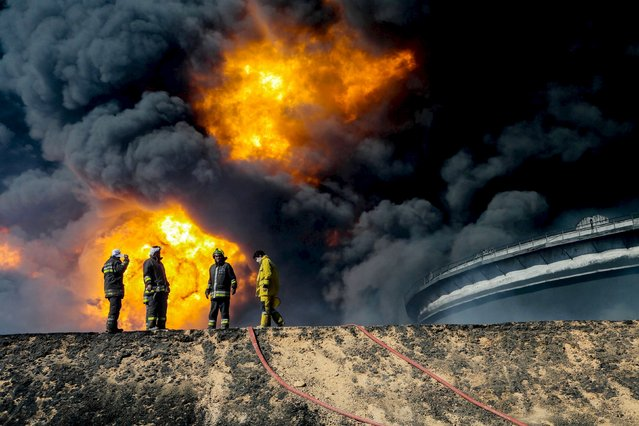 Firefighters try to put out the fire in an oil tank in the port of Es Sider, in Ras Lanuf, Libya, in this file picture taken January 6, 2016. (Photo by Reuters/Stringer)