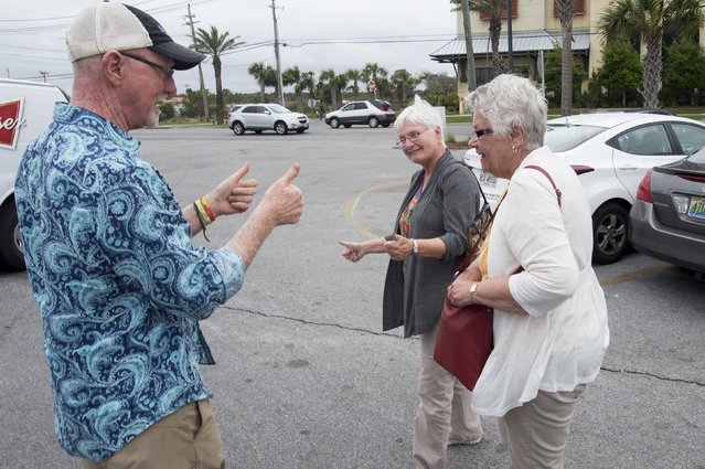 Sharky's Beachfront Restaurant owner Mike Bennett (L) greets Nancy Matheny and Lynette Doolen of Delafield, Wisconsin. as they arrive at his restaurant for lunch during spring break festivities in Panama City Beach, Florida March 13, 2015. (Photo by Michael Spooneybarger/Reuters)