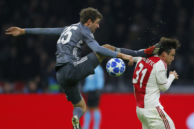 Ajax's Nicolas Tagliafico, right, is fouled by Bayern's Thomas Mueller during the Champions League group E soccer match between Ajax and FC Bayern Munich at the Johan Cruyff Arena in Amsterdam, Netherlands, Wednesday, December 12, 2018. (Photo by Peter Dejong/AP Photo)