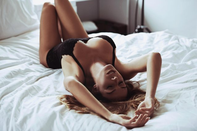 Waking up with sexiness. A beautiful young woman lying on her bed wearing black lingerie. (Photo by PeopleImages/Getty Images)