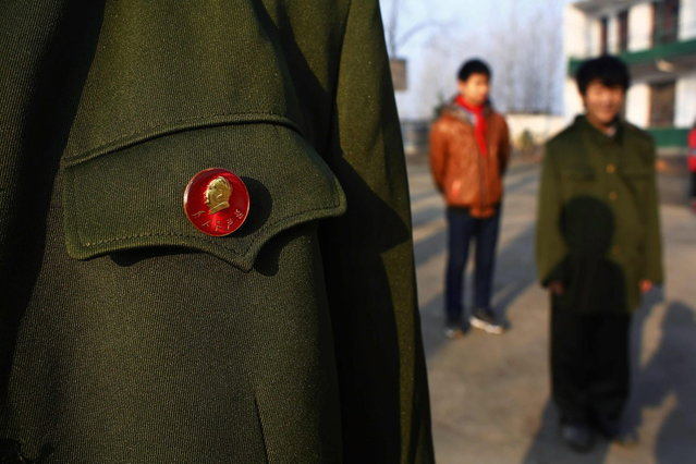 A student wears a pin button of China's late chairman Mao Zedong during a ceremony at the Democracy Elementary and Middle School in Sitong town, Henan province December 4, 2013. (Photo by Carlos Barria/Reuters)