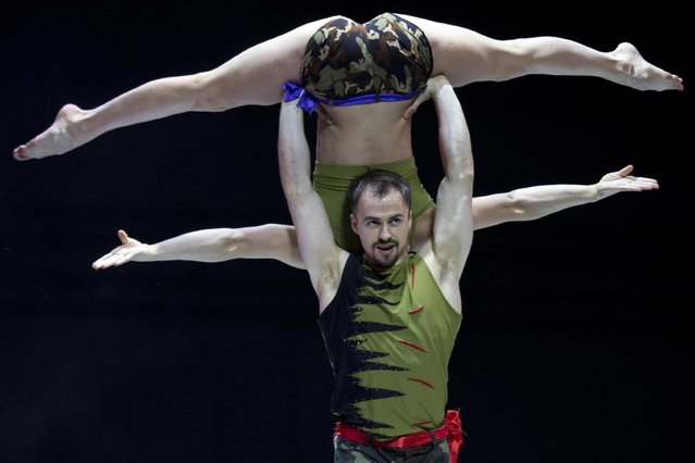 Ukraine's Hanna Antonova and Andril Kopyniak compete at the 2015 World Pole Dance Championships held in Beijing, Sunday, April 12, 2015. (Photo by Ng Han Guan/AP Photo)