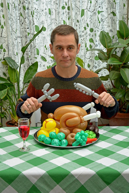 """Rob with a balloon roast dinner and cutlery"". (Photo by Rob Driscoll/Caters News Agency)"