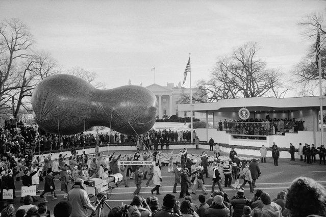 A peanut-shaped float passes by the Review Stand for the inauguration of Jimmy Carter in Washington, D.C., U.S. January 1977. (Photo by Marion S. Trikosko/Reuters/White House Photo/Library of Congress)