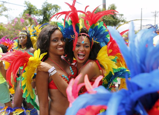 Revelers take part during the Jamaica Carnival Road march in Kingston April 12, 2015. (Photo by Gilbert Bellamy/Reuters)