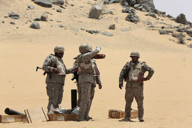 Saudi soldiers prepare to fire artillery towards the border with Yemen in Najran, Saudi Arabia, Tuesday, April 21, 2015. (Photo by Hasan Jamali/AP Photo)