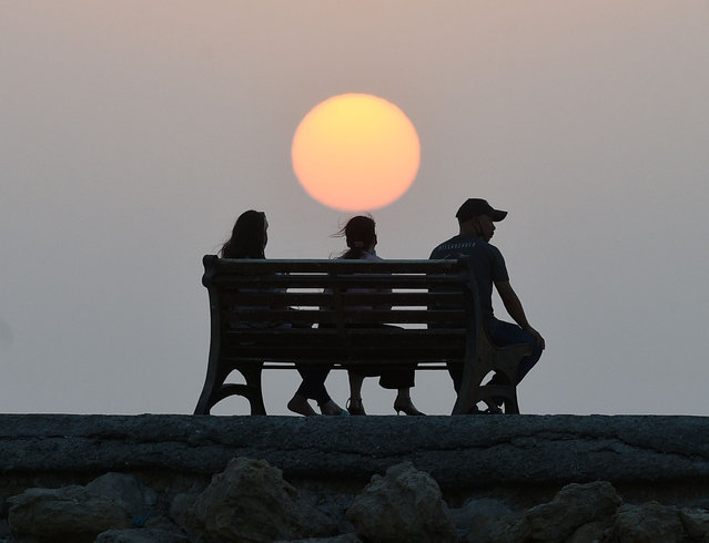 Photo taken on July 24, 2021 shows a sunset view in Capital Governorate, Kuwait. (Photo by Xinhua News Agency/Rex Features/Shutterstock)