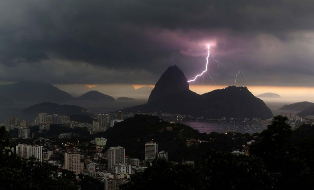 Lightning lights up the the sky over Sugar Loaf mountain in Rio de Janeiro, on January 16, 2014. An alert was called by Rio authorities due to heavy rains and the possibilty of floods in the city. (Photo by Leo Correa/Associated Press)