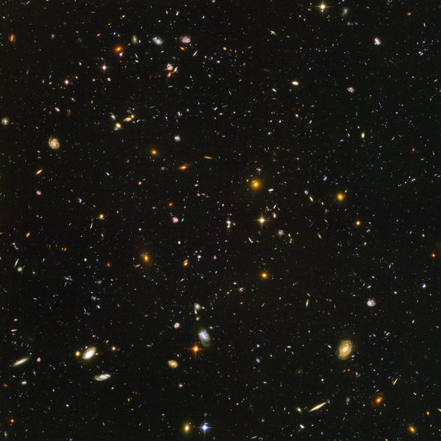 This image made by the NASA/ESA Hubble Space Telescope shows nearly 10,000 galaxies in the deepest visible-light image of the cosmos, cutting across billions of light-years. (Photo by NASA, ESA, S. Beckwith (STScI), HUDF Team via AP Photo)