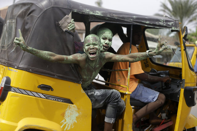 Supporters of Nigeria's incumbent President Muhammadu Buhari, of the All Progressives Congress party, celebrate his victory after he was declared the winner of the presidential election, in Yola, Nigeria Wednesday, February 27, 2019. Nigeria's president was declared the clear winner of a second term in Africa's largest democracy early Wednesday, after a campaign in which he urged voters to give him another chance to tackle gaping corruption, widespread insecurity and an economy limping back from a rare recession. (Photo by Sunday Alamba/AP Photo)