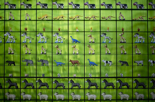 In this April 11, 2015 photo, animal figurine prizes stand on display inside the booth of a shooting game at the Texcoco Fair on the outskirts of Mexico City. The fair is held every spring just west of the capital. (Photo by Eduardo Verdugo/AP Photo)