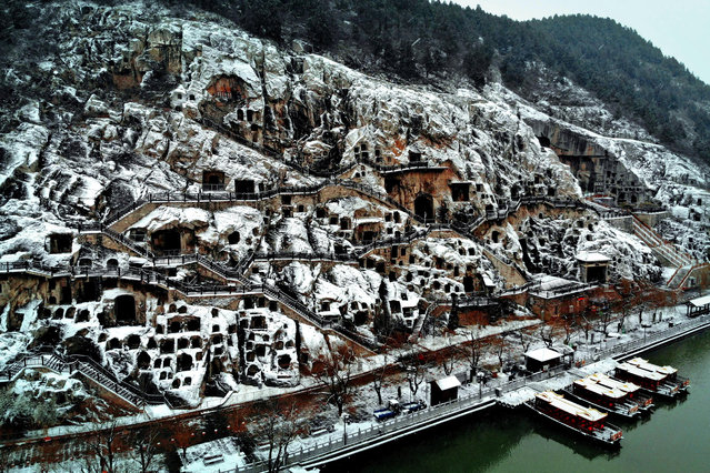 The snow-covered Longmen Grottoes in Luoyang, Henan Province, central China on January 5, 2019. (Photo by Xinhua News Agency/Barcroft Images)
