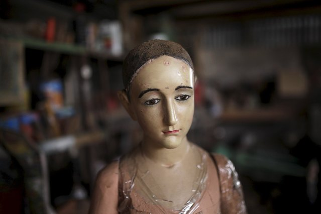 A statue of an angel which is ready to be restored is seen at Jose Sabas Gomez's workshop in Apastepeque, El Salvador, March 9, 2016. (Photo by Jose Cabezas/Reuters)