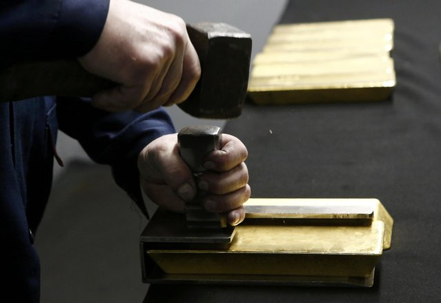 An employee stamps gold bars at the Prioksky Non-Ferrous Metals Plant in Kasimov, Russia February 14, 2017. (Photo by Sergei Karpukhin/Reuters)