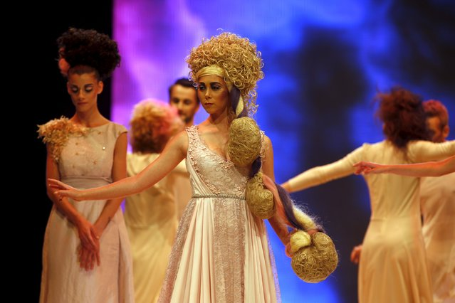 Models present creations by Maltese hairstylist Mario Muscat of Moi & Tu at the Malta Fashion Awards 2015 at the Marsa Shipbuilding warehouse in Marsa, outside Valletta in Malta, May 16, 2015. (Photo by Darrin Zammit Lupi/Reuters)