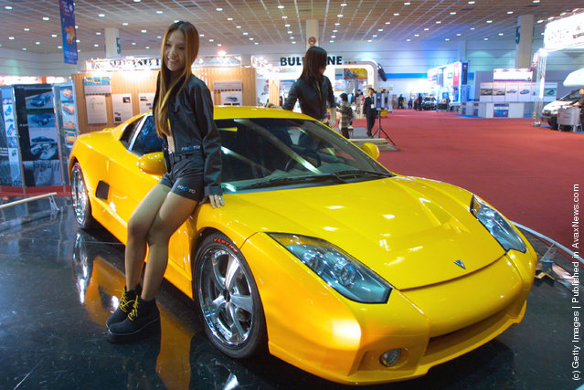 Models pose with the latest car SPARRA from Japanese car manufacturer Toyota at the Seoul Motor Show