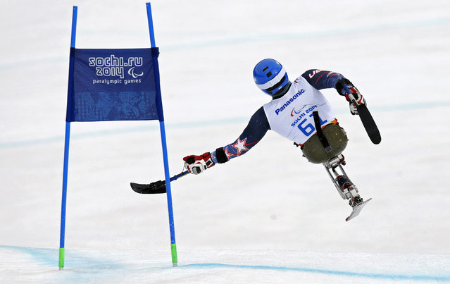 Tyler Walker of the U.S. crashes as he takes a jump during the men's sitting skiing downhill at the 2014 Sochi Paralympic Winter Games at the Rosa Khutor Alpine Center March 8, 2014. (Photo by Christian Hartmann/Reuters)