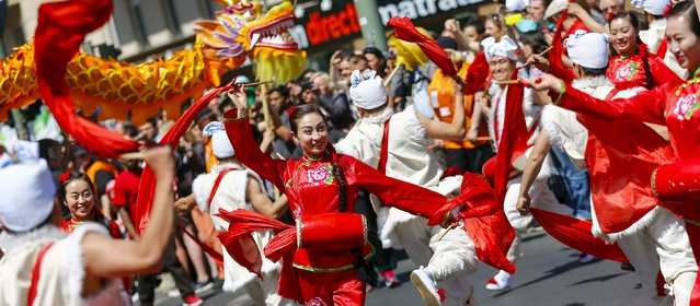 Dancers take part in the Karneval der Kulturen (Carnival of Cultures) street parade of ethnic minorities, in Berlin, Germany, May 24, 2015. (Photo by Hannibal Hanschke/Reuters)