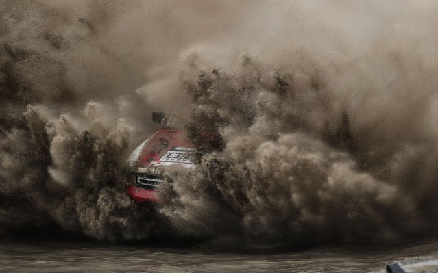 Gu Zhijian of Vehicles Servant Team 1 competes during the China Offroad Championship (COC) in Fuxin, northeast China's Liaoning province, June 17, 2019. (Photo by Pan Yulong/Xinhua News Agency)
