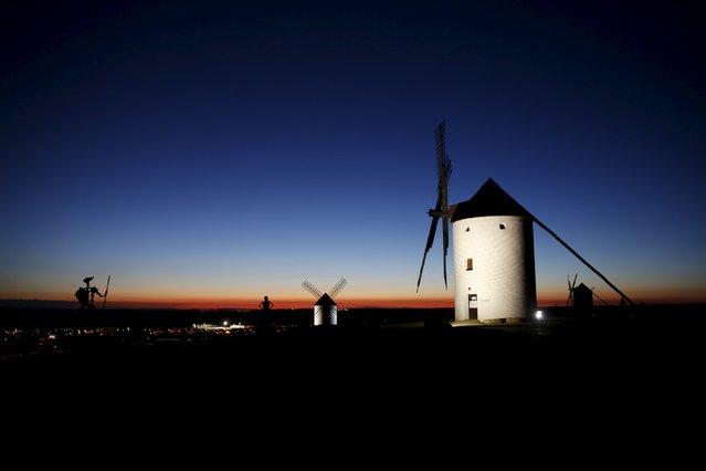 "Sculptures of Don Quixote (L) and his ladyship Dulcinea (C) are seen at dusk by the windmills of Mota del Cuervo, Spain, April 6, 2016. The arid central Spanish region of La Mancha is the setting for ""Don Quixote"", the seventeenth-century novel by Miguel de Cervantes. Four hundred years after his death, references to the characters of Don Quixote, his loyal squire Sancho Panza and his beautiful lady Dulcinea abound in the surrounding villages from sweet treats to theatre productions involving livestock. Cervantes did not give away the name of the birthplace of Don Quixote, a middle-aged gentleman who becomes obsessed with chivalrous ideals. But many identify the village of Argamasilla de Alba as his hometown. The anniversary of Cervantes' death is marked on the 23 April. (Photo by Susana Vera/Reuters)"